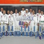 In June, 13 students from the Dogwood Ridge Tokoshi Martial Arts Dojo competed at the Smoky Mountain Classic Karate for Christ World Championship Karate tournament that was held in Pigeon Forge, Tennessee. Pictured front row L-R: Leann Howard who placed first in Weapons Kata, second in Open-Hand Kata and third in Kumite (fighting), Tucker Merritt finished second in Weapons Kata and second in Fighting, Reuben Thayer finished first in Kata and first in Weapons Kata, Alexander Thomas finished second in Fighting, third in Kata and third in Weapons Kata, Rama Soumakieh finished first in Fighting, second in Kata and second in Weapons Kata, Aya Soumakieh finished first in Fighting and second in Kata, and Tate Duncan finished first in Kata, first in Weapons Kata and second in Fighting. Back row L-R: Randy Hiles, instructor, Jessica Howard finished first in Kata, first in Weapons Kata and second im Fighting, Victoria Thomas finished third in Weapons Kata and first in Fighting, Chase Wagner finished second in Kata, second in Weapons Kata and second in Fighting, Tanner Baldridge finished first in Kata, first in Weapons Kata and second in Fighting, Malek Soumakieh finished first in Kata, first in Weapons Kata and first in Fighting and Conner Emnett finished first in Fighting and third in Weapons Kata.