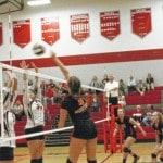 Chris Slone | PDT SportsMadisyn Dillow (4) spikes the ball Tuesday night as the West Senators beat the Minford Falcons in straight sets.