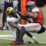 With playoff spots at stake, Ohio St beats Michigan in 2OT