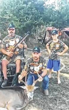 Richard Bell, veteran, his son Andy, and his youngest son, Tilon after the hunt.