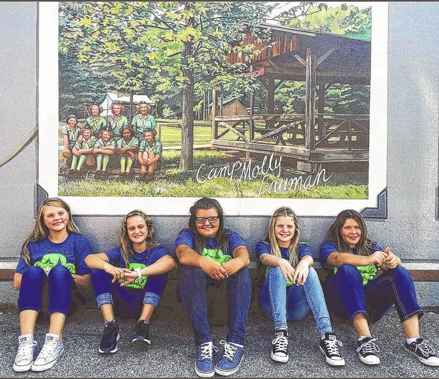 Girls Scouts: Abby Webb, Mia Crum, Hunter Slack, Maelynn Howell and Savannah Williams in front of the Girl Scout Mural in Portsmouth.
