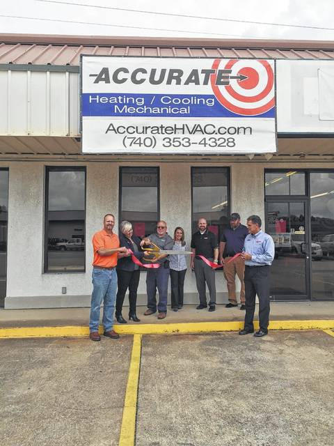Charlie Workman, Rochel Wolfe, Chuck Martin, Hannah Allen, Bob Orsini, Tom Martin, and owner, Michael Linton cutting the ribbon for Accurate Heating and Cooling in Wheelersburg.