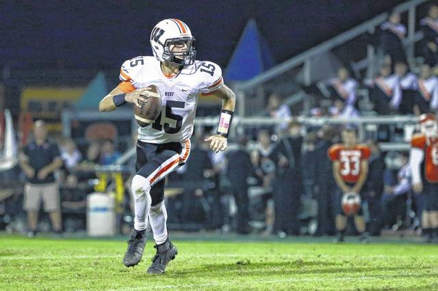 Dylan Bradford rolls out to his right against Raceland.