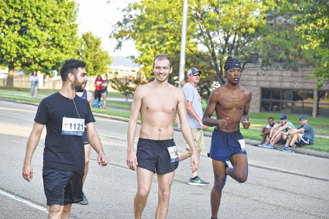 A trio of runners warm up before the start of the Shawnee State Bear Run.