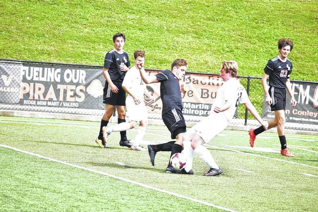 South Webster's Samuel Holstein and Wheelersburg's Chayden Holbrook fight for ball possession on Saturday afternoon in Wheelersburg.