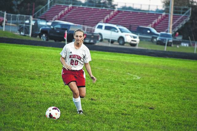 Minford's Aspen Lambert runs upfield with the ball during a match against Northwest.