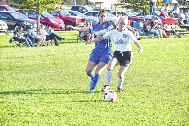 West's Haleigh Williams (19) and Northwest's Abby Blanton (22) go after a ball on Monday evening in West Portsmouth.