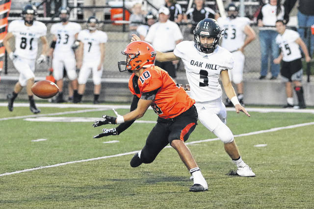 Wheelersburg's Bryson Keeney haules in a pass from Trent Salyers last Friday against Oak Hill.