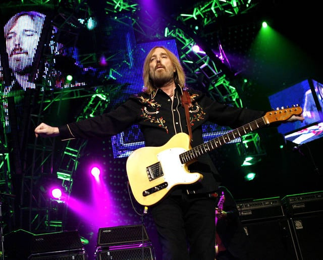 FILE - In this June 17, 2008 file photo, Tom Petty performs with The Heartbreakers at Madison Square Garden in New York. Petty has died at age 66. Spokeswoman Carla Sacks says Petty died Monday night, Oct. 2, 2017, at UCLA Medical Center in Los Angeles after he suffered cardiac arrest. (AP Photo/Jason DeCrow, File)