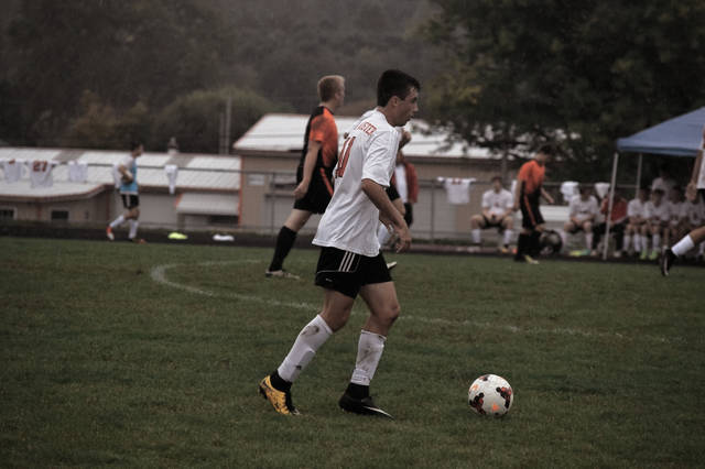 South Webster's Devyn Coriell gets ready to launch a free kick on Tuesday evening in South Webster.