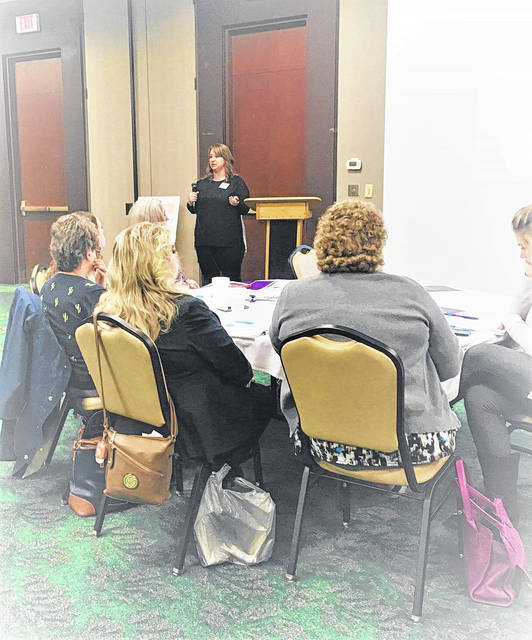 The Grief and Compassion Fatigue speaker, Rev. Hannah Niday, speaking to a breakout group.