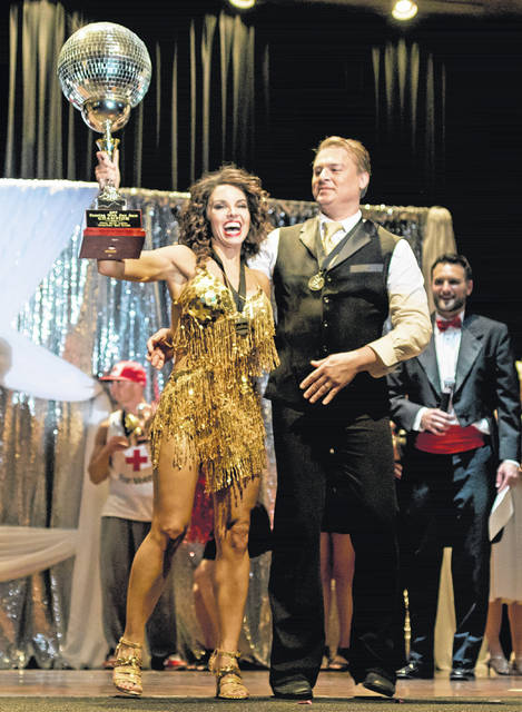 Dr. Kemmely Hochstetler who raised more than $90,000 to win the 2017 Mirror Ball trophy with her dance partner Dr. John Turjoman.