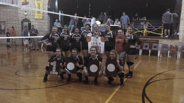 Ali Hamilton poses with her teammates for a photo after obtaining 1,000 career kills against Ironton St. Joseph in a 3-1 victory. Hamilton now has 1,004 kills for her career.