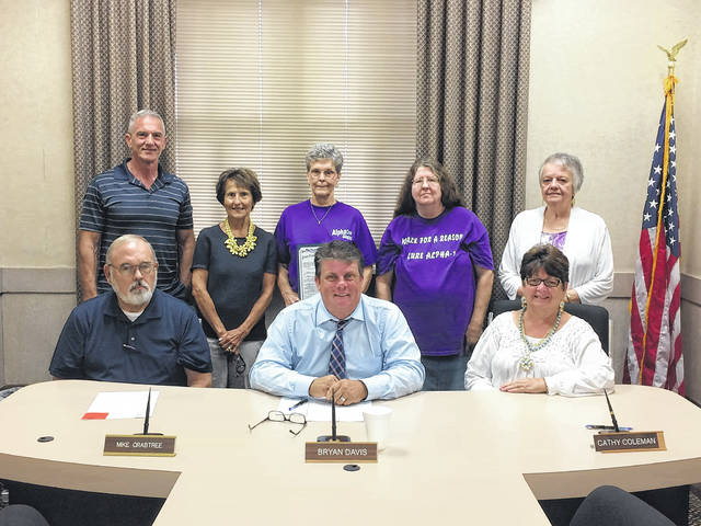 (Left to right) Mike Crabtree, Bryan Davis, and Cathy Coleman. Standing: Jesse Strickland, Ann Kirby, Ann Dissinger, co-leader, Barb Cooley, and Janet Delay. The local Alpha-1 Foundation support group Strickly Alphas was presented a resolution from the Scioto County Commissioners for acknowledging the month of November Alpha-1 Antitrypsin Deficiency Awareness month.