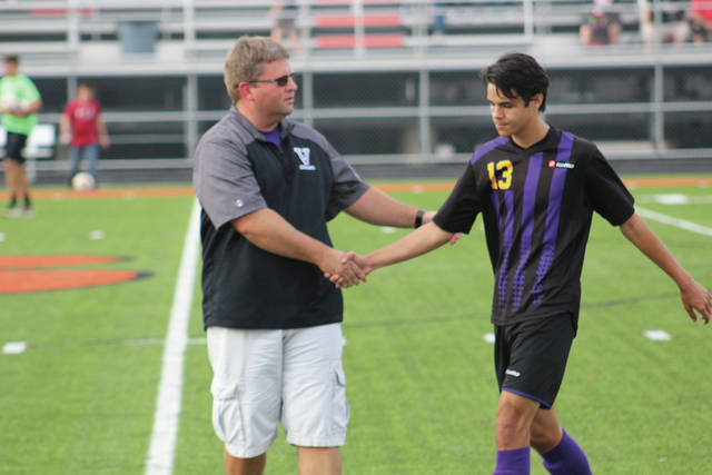 Valley head coach Andy Johnson shakes hands with senior Brandon Phillips after the match.