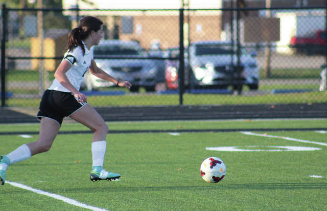 Wheelersburg's Libby Miller looks to score with an opening against Peebles. Miller scored two goals in the game for the Pirates.