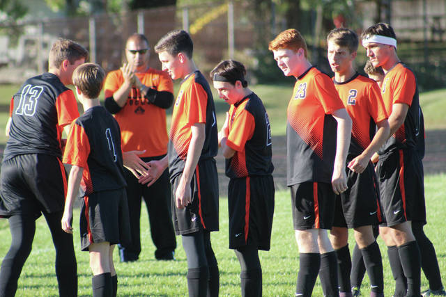 Wheelersburg players are introduced before the match against Minford.