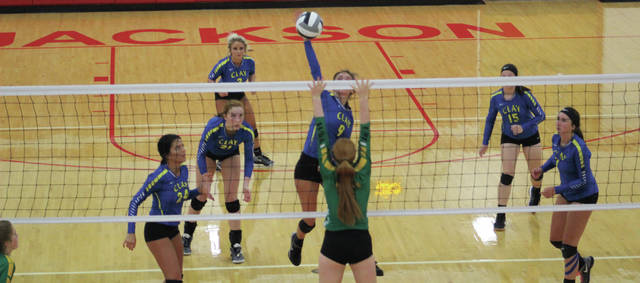 Taylor Lewis sends a ball back to Eastern. Lewis had a big game at the net for Clay.