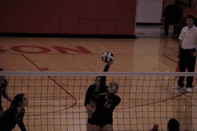 New Boston's Kaylee Stone goes up for an attack attempt on Thursday evening.