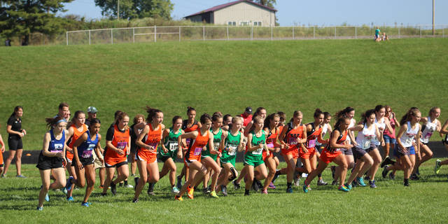 Runners begin a race earlier this season at the Minford Invitational