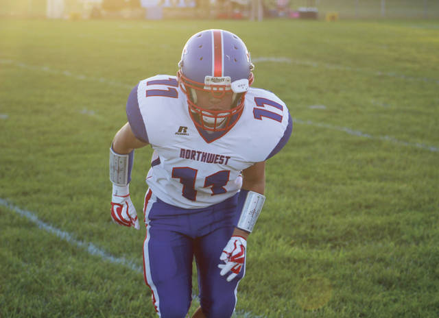 Northwest senior Will Gillette warming up on the field before the game against Green.