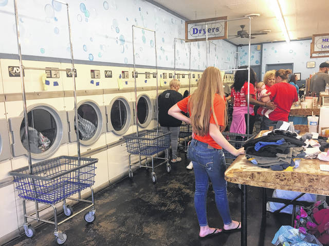 Church members packed the laundromat to wash clothes