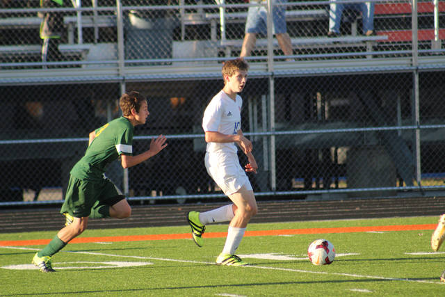 Northwest's Evan Throckmorton looks to create on offense. Throckmorton had one goal and two assists in the match.