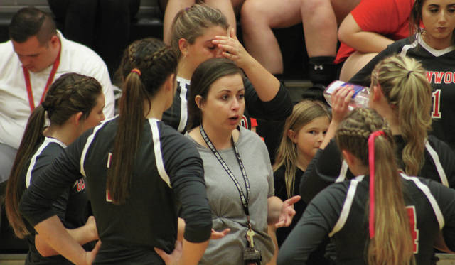 New Boston head coach Kendra Holbrook addresses her team during a timeout.