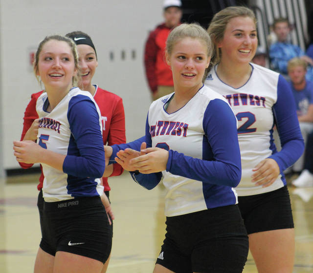 Northwest volleyball had plenty to be happy about on Tuesday night, as the Mohawks won their district tournament game and Mollie Ferrar (left) recorded 1,000 career kills.