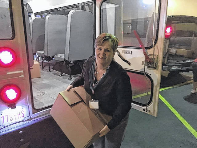 Sandy Smith, Principal of Bloom-Vernon Elementary, unloading items for the Steven A. Hunter Power Packs