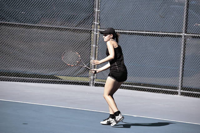 Wheelersburg's Lea Wright watches her serve go over the net during sectional play on Wednesday.