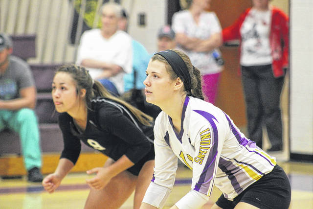 Valley's Rylie Smith (8) and Chalee Hettinger (13) get prepared for a Clay serve.