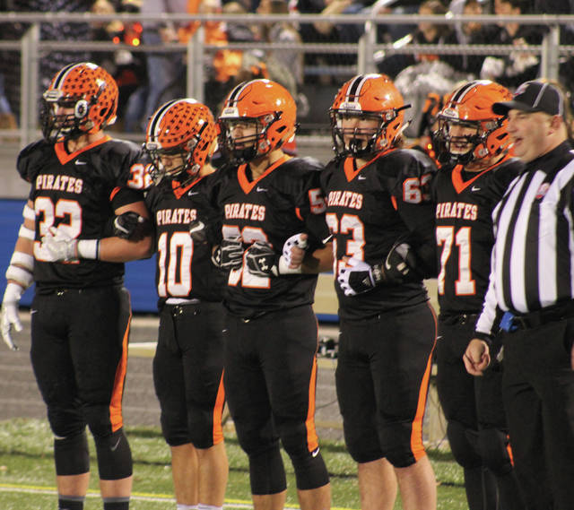 Wheelersburg captains get set for the coin toss. (Left to right: Xander Carmichael, Bryson Keeney, Alex George, Nic Parsley, CJ Hall)