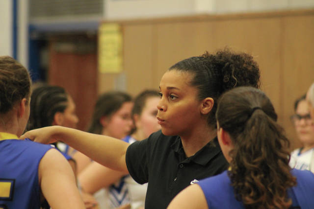 Clay head coach Sthefany Thomas chats with her team during a timeout. It was the first game as Panthers head coach for Thomas.