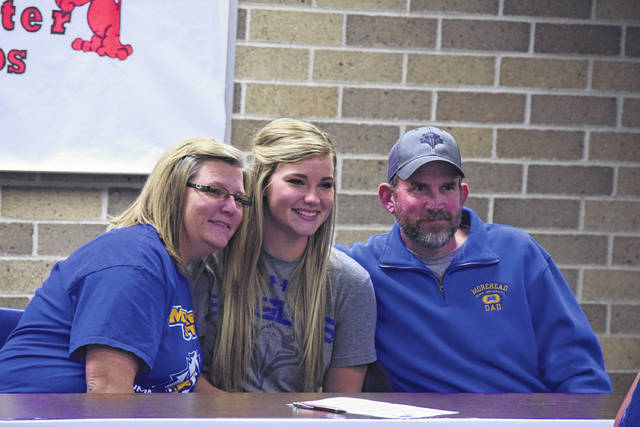 Kristie Johnson, Ellie Jo Johnson, and Shane Johnson pose for a picture.