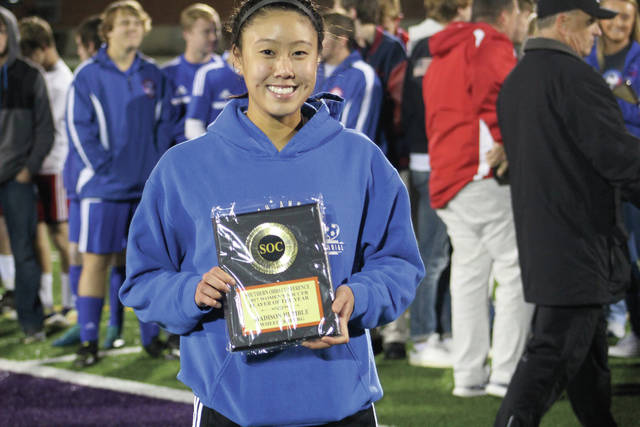 Humble shows off her SOC Player of the Year award.