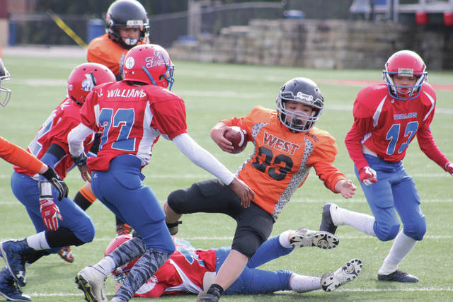 Jase Hurd looks to break a tackle inside the red zone. Hurd had two rushing touchdowns on the day.