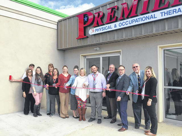 The staff of Premier physical and occupational therapy cut the ribbon for their recent relocation.