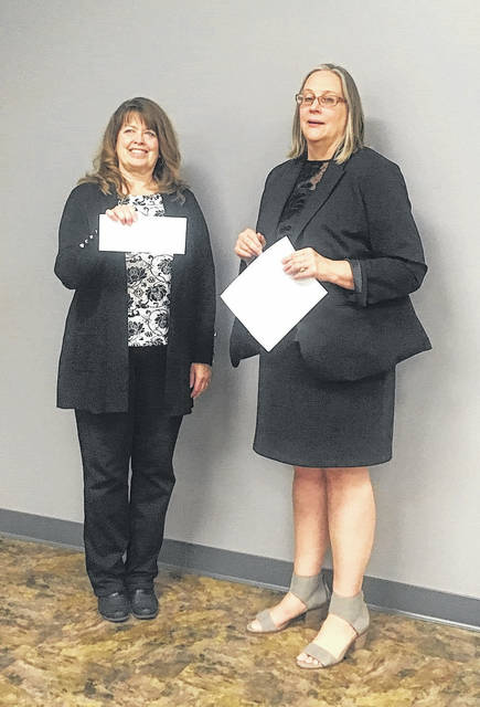Left to right: Sharee Price, the South Central Ohio Educational Service Center receiving her endowment from Kim Cutlip, Scioto Foundation Executive Director.