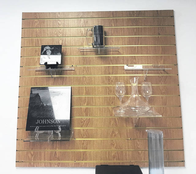 Pictured is the piece of oak that has been custom etched and displays some of the other etchings and photos that can be done at Southern Ohio Vault Co.