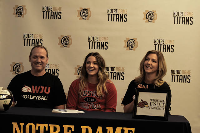 From left to right: Joe Smith (father, left), Lexi Smith (center), and Lisa Smith (mother, right) smile after Smith's official signing with Wheeling Jesuit on Wednesday evening at Notre Dame High School.