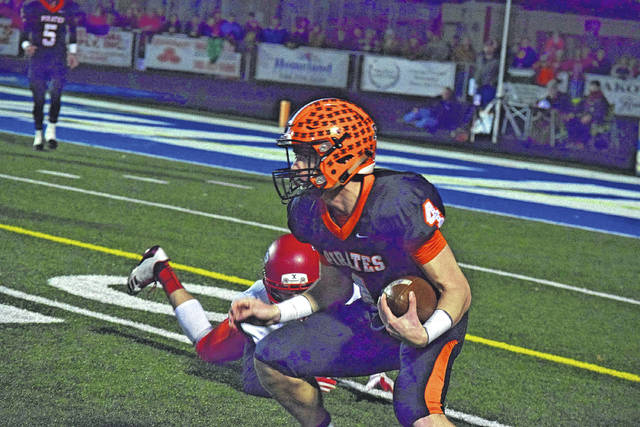Wheelersburg's Cole Lowery attempts to gain yards after the catch against Middletown Madison on Friday evening. Lowery caught four passes for 40 yards in the contest and accumulated the game-winning interception that sealed the deal in the Pirates' favor.