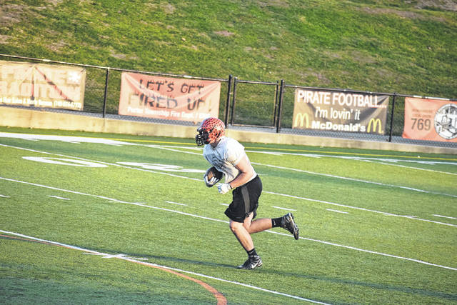 Wheelersburg's Xander Carmichael carries the football during practice.