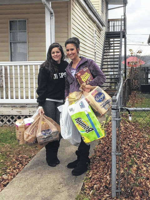 (Left to right) Jesica Payne and Jacklyn Brisker carrying donations.