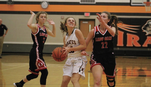 Wheelersburg's Kaylee Darnell drives to the rim for a basket in the first half.