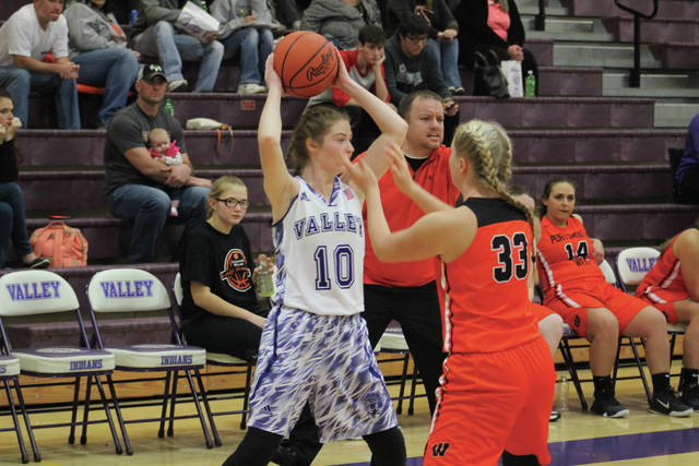 Valley's Bre Call looks for a teammate to pass the ball to early in the game against West.
