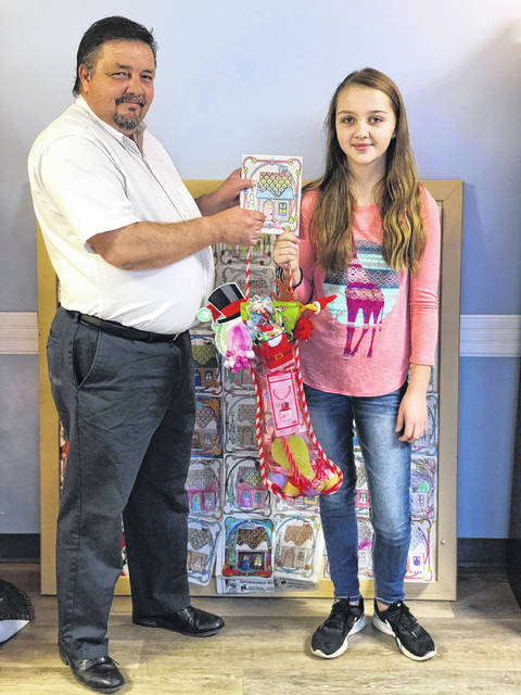 Mike Bell, Sales Representative for the Daily Times with the coloring contest winner, Breanna Conkel from New Boston.