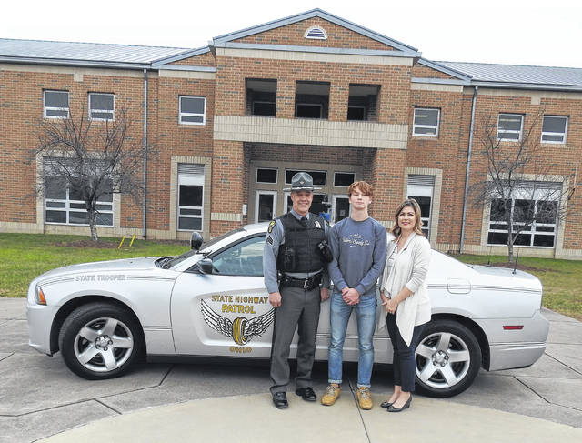 Officer Howard, Harald Rundquist from NWHS and Sweden, and Leigh Greene from State Farm