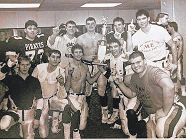 The 1989 Wheelersburg Pirates celebrate with their state title following their 14-7 victory over Warren John F. Kennedy in Columbus.