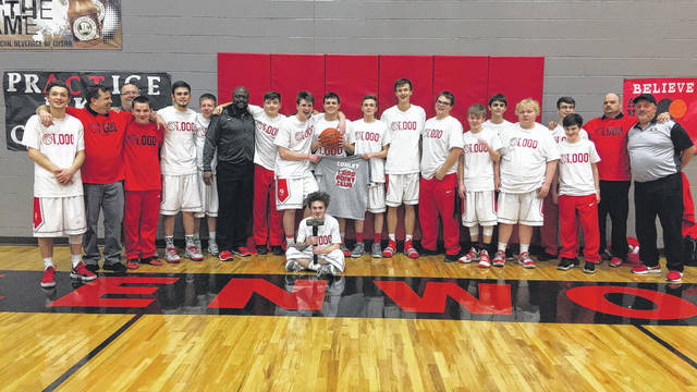 New Boston's Kade Conley celebrates with his team after eclipsing the 1,000-point plateau with 27 points in an 89-76 victory over Symmes Valley on Tuesday evening. Conley now has 1,009 points for his career.